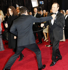 Actor Josh Brolin playfully boxes with actor Kevin Spacey at the 83rd Academy Awards in Hollywood