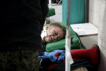 A boy reacts after being wounded following what activists said were three consecutive air strikes carried out by the Russian air force, at a field hospital in the rebel-controlled area of Maaret al-Numan town in Idlib province, Syria
