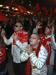 Lille soccer fans cheer as they watch a giant screen in central Lille as their team wins the French Cup final against Paris Saint-Germain at the Stade de France