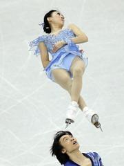 Pang and Tong of China perform during the pairs free skating competition at the ISU Grand Prix of Figure Skating Final in Sochi