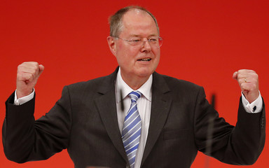 Steinbrueck, top candidate of the German Social Democratic Party (SPD) receives standing ovations after his speech during the extraordinary party meeting of the SPD in Augsburg