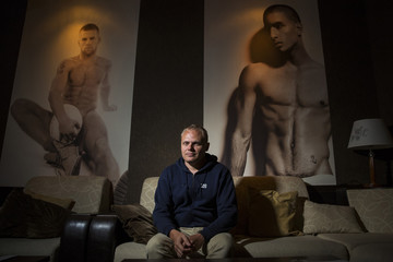 Co-owner of a gay cabaret club, the Mayak, Andrey Tanichev poses for a photograph in his venue in Sochi