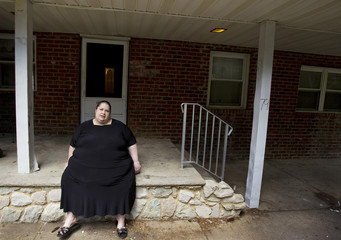 Donna Simpson poses for a portrait at her home in Old Bridge, New Jersey