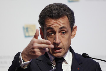 France's President Sarkozy delivers a speech at a symposium hosted by the Institute for Justice in Paris
