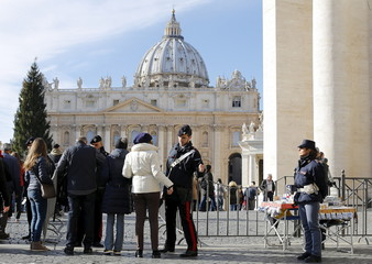 Italian Carabinieri officers check a person before the Pope Francis' Sunday Angelus prayer in St.Peter's square at the Vatican