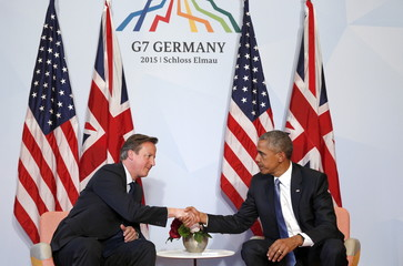 U.S. President Barack Obama (R) meets with British Prime Minister David Cameron at the G7 Summit in Kruen, Germany