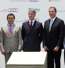 Audi CEO Rupert Stadler, Mexican Economy Minister Ildefonso Guajardo and Rafael Moreno Valle, governor Puebla, pose during the opening ceremony for the carmaker's new plant in San Jose Chiapa