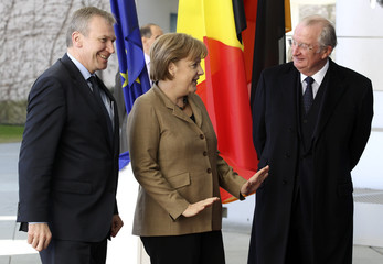 German Chancellor Merkel talks to Belgium's King Albert as Belgian Prime Minister Leterme listens during their visit at the Chancellery in Berlin