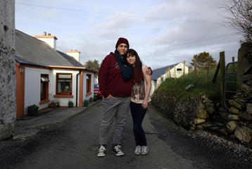 Clare Barrett Butler and her daughter Lily Barrett McHugh pose for a photograph outside their house in a small hamlet near the village of Ardara in County Donegal
