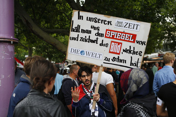 A demonstrator holds a placard during a Muslim protest against the Israeli assault on the Gaza Strip in Berlin