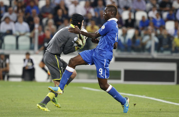 Italy's Balotelli fights for the ball with Czech Republic's goalkeeper Cech during their 2014 World Cup qualifying soccer match at the Juventus stadium in Turin