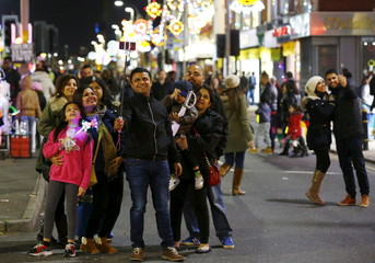 A family pose for a selfie during Diwali celebrations in Leicester