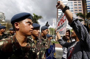 """Soldiers block members of """"Bayan"""" (My Country) activist group near the U.S. embassy in Manila"""