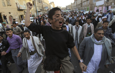 A boy shouts slogans during a demonstration in Sanaa