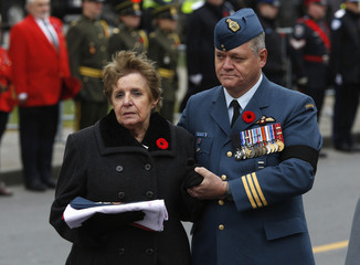 Mother of Warrant Officer Patrice Vincent, Guerette Vincent, holds her son's cap and medals with the Canadian flag that adorned his coffin, following his funeral in Longueuil