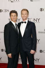 Host Harris and partner Burtka arrive for the American Theatre Wing's 65th annual Tony Awards ceremony in New York