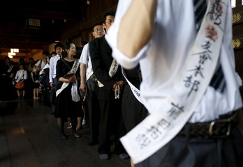 Worshippers queue to enter the main shrine as they offer prayers at Yasukuni Shrine in Tokyo