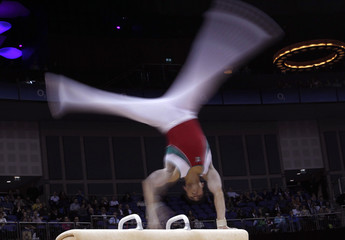 Daniel Corral Barron of Mexico performs on the pommel horse at the International Gymnastics event in east Londo