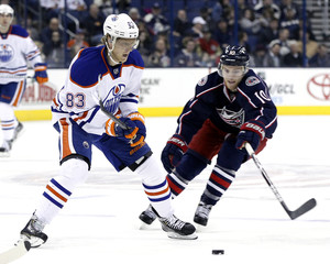 Edmonton Oilers' Ales Hemsky fights for the puck with Columbus Blue Jackets' Mark Letestu during the third period of their NHL hockey game in Columbus