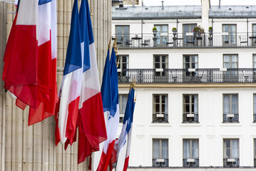 Row of French flags on columns of Pantheon in Paris