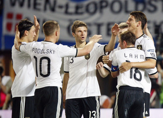 Germany's Oezil, Podolski, Mueller, Lahm und Gomez celebrate a goal against Austria during their Euro 2012 Group A qualifying soccer match at the Ernst Happel stadium in Vienna