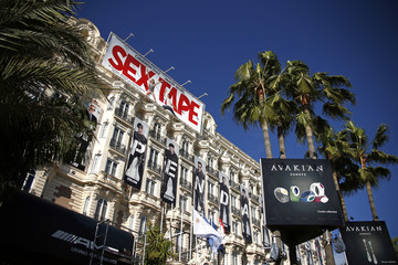 View of the Carlton Hotel with movie billboards as preparations continue ahead of the 67th Cannes Film Festival in Cannes