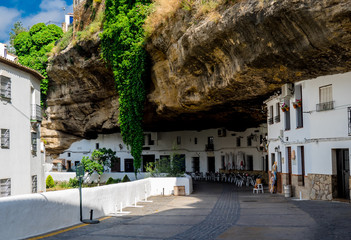 """Setenil de las Bodegas"" Cityscape in Spain. White village in Cadiz, Andalusia. Sunshine tourism in summer."