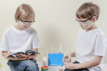 Kids preparing to make science experiments. Education concept.
