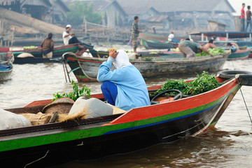 Indonesia, Borneo. For seller on the floating market near the Banjarmasin city on the Martapura river.