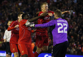 Liverpool's Lucas Leiva celebrates with teammate Simon Mignolet after winning the penalty shootout against Middlesbrough in their League Cup soccer match at Anfield in Liverpool