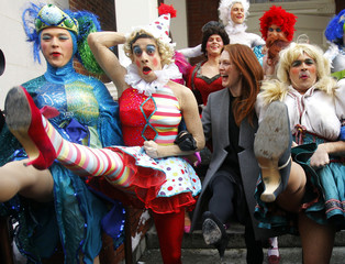 """Actress Moore and Hasty Pudding theatricals cast members dance as she is honoured as the """"Hasty Pudding Theatricals Woman of the Year"""" in Cambridge"""