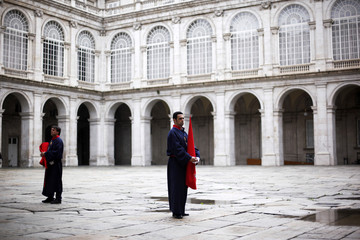 Penitents wait inside the Royal Palace to start the procession of the 'Santisimo Cristo de los Alabarderos' brotherhood during Holy Week in Madrid