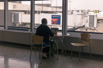 Man at table in airport