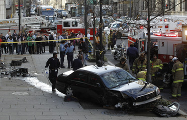 Washington D.C. fire, rescue and police work at the scene of a late afternoon accident in Washington