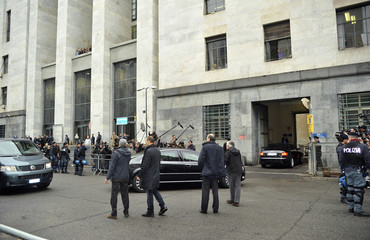 Italy's Prime Minister Silvio Berlusconi arrives in his car at the Justice Palace in Milan