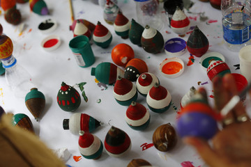 Hand-made spinning tops to be sent to children in Gaza are seen on a table in Caracas.