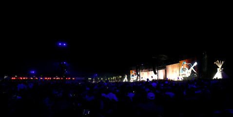 Concertgoers watch the performance by musician Neil Young at the Desert Trip music festival at Empire Polo Club in Indio