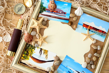 Travel concept. Composition with photos and paper on bamboo mat background