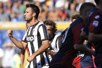 Juventus' Mirko Vucinic celebrates after scoring against Genoa during their Italian Serie A soccer match at the Ferraris stadium in Genoa
