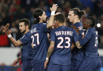 Paris Saint Germain's players celebrate after Ibrahimovic scored a penalty against Nice during their French Ligue 1 soccer match at the Parc des Princes Stadium in Paris