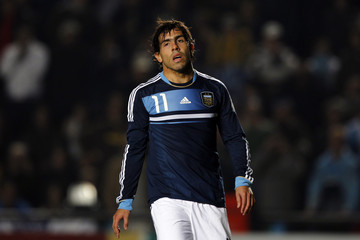 Argentina's Carlos Tevez walks away after his penalty kick was blocked by Uruguay's goalkeeper Fernando Muslera during their quarter-final soccer match at the Copa America in Santa Fe