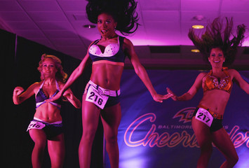 """Baltimore Ravens cheerleader hopefuls perform during an event called """"Making the Cut"""" to select the 2011 Ravens cheerleaders in Baltimore"""