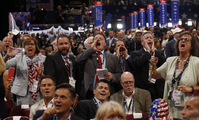 Republican National Convention delegates yell and scream at the Republican National Convention in Cleveland
