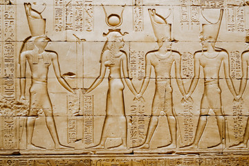 Reliefs of Egyptian hieroglyphs on wall at Horus Temple. Edfu. Egypt