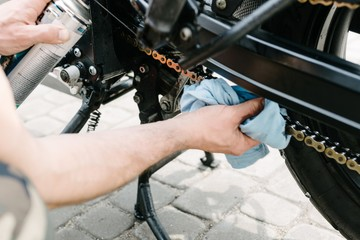 Main cleans motorbike chain