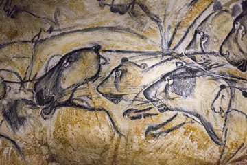 A replica of pre-historic drawings showing lions is seen on a wall during a press visit at the site of the Cavern of Pont-d'Arc project in Vallon Pont d'Arc
