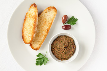 olive pate and fried white bread slices