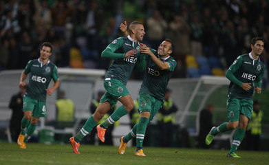Sporting's Slimani celebrates his goal with his teammate Jefferson Nascimento during their Champions League Group G soccer match against Schalke at Alvalade stadium in Lisbon