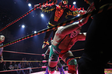 Lucha libre wrestlers Dr. Maldad and a member of The Crazy Chickens fight during the Lucha VaVOOM show at the Mayan Theatre in Los Angeles