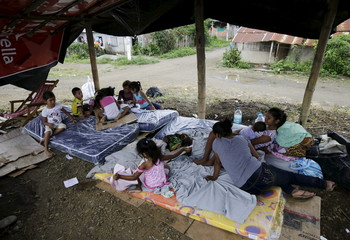 Children are pictured under a tent which is used as a shelter, after being evacuated from their homes, in Pedernales